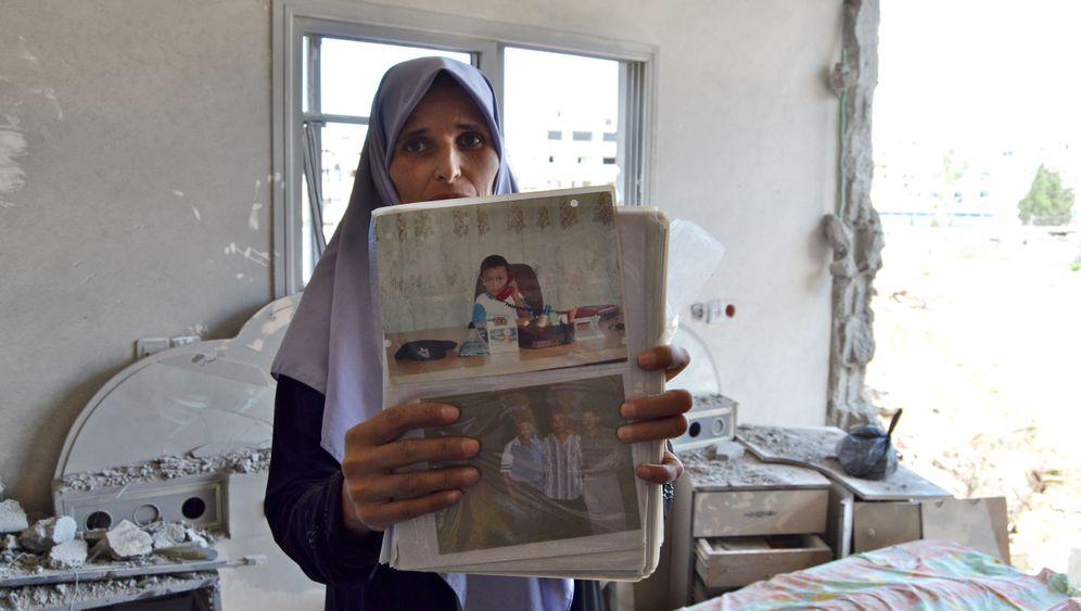 Krieg in Gaza: Menschen in Trümmern