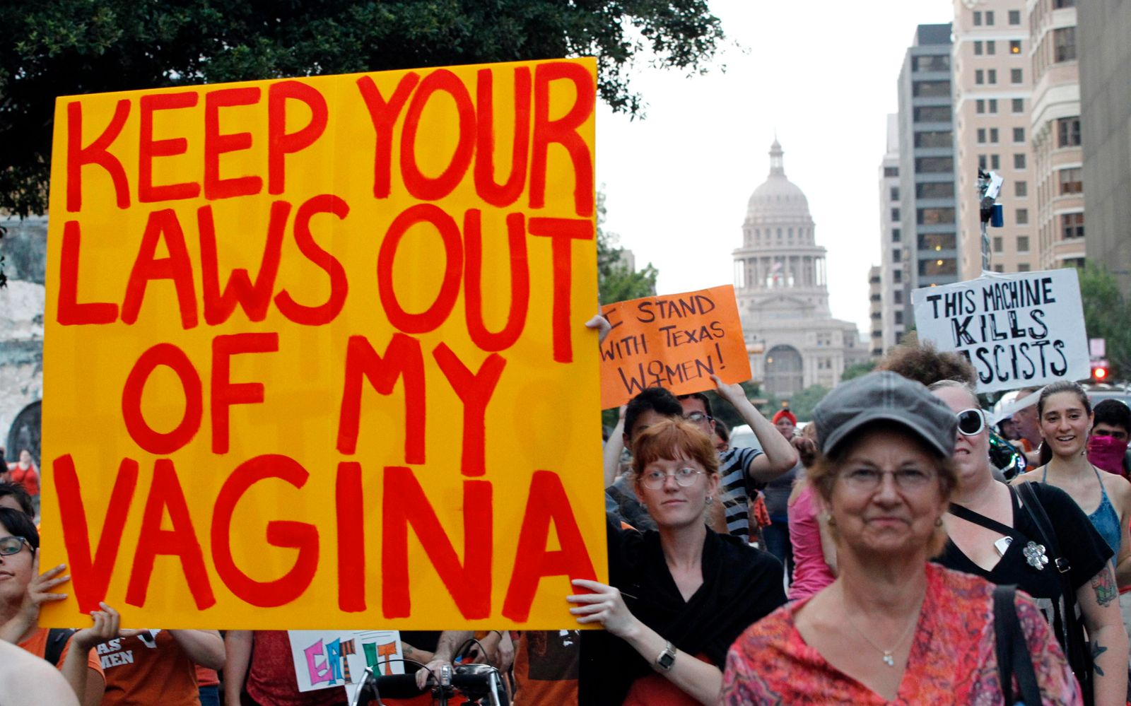 Minter carries a sign during an abortion rights march in Austin