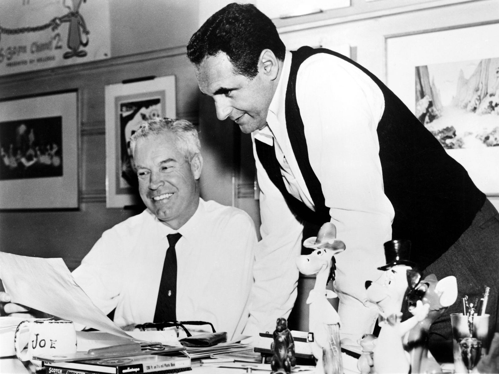 William Hanna and Joseph Barbera, in their office, going over the script for debut of THE FLINTSTONES, 9/30/1960. Courte