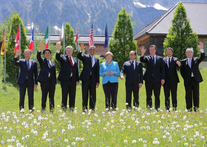 Merkel unter Männern: Ein Anblick, an den man sich gewöhnt hat