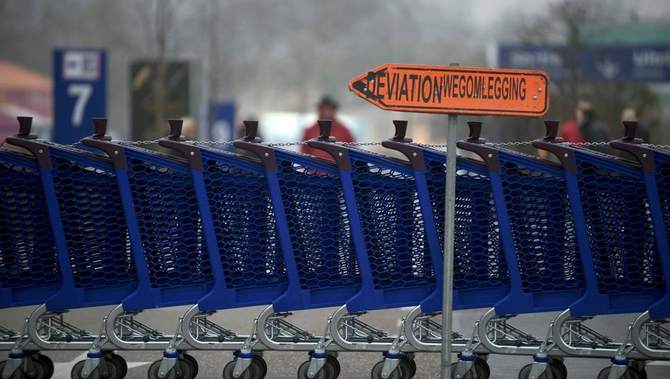 Shopping carts block the entrance to a supermarket in Brussels as part of a 24-hour general strike called to protest austerity measures.