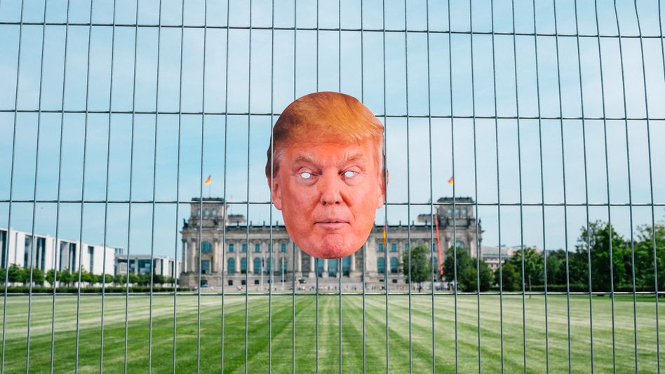 A Donald Trump mask against the background of Berlin's Reichstag