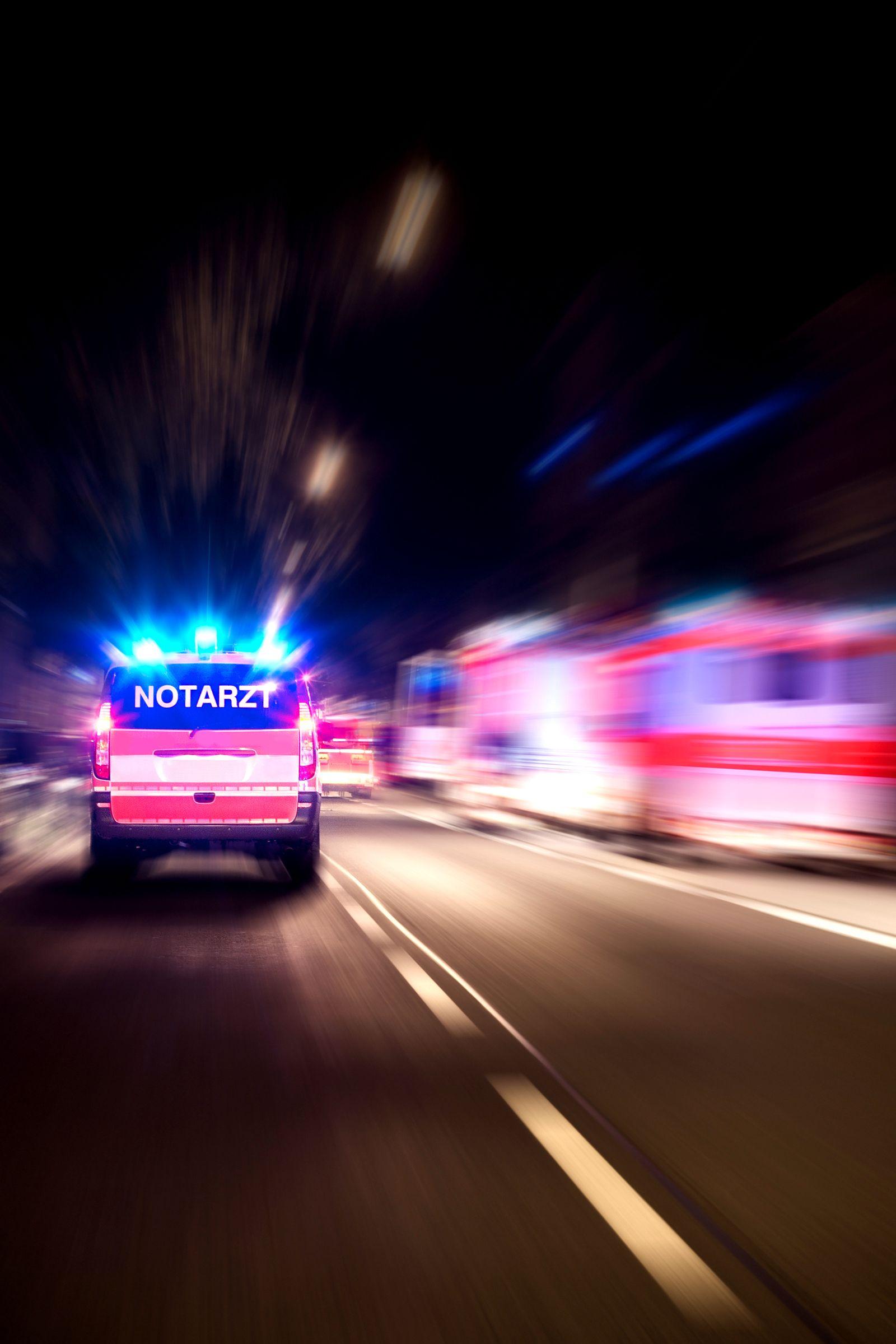 Arriving german emergency ambulance, motion blur