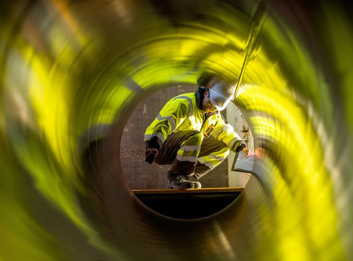 A worker tests pipes for the future Nord Stream 2 Baltic Sea gas pipeline.