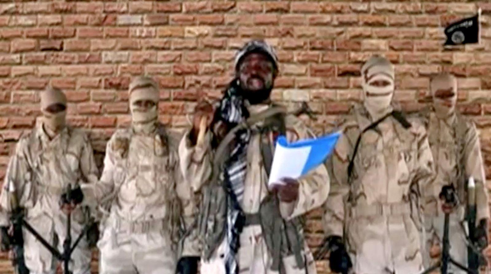 FILE PHOTO: Boko Haram leader Abubakar Shekau speaks in front of guards in an unknown location in Nigeria