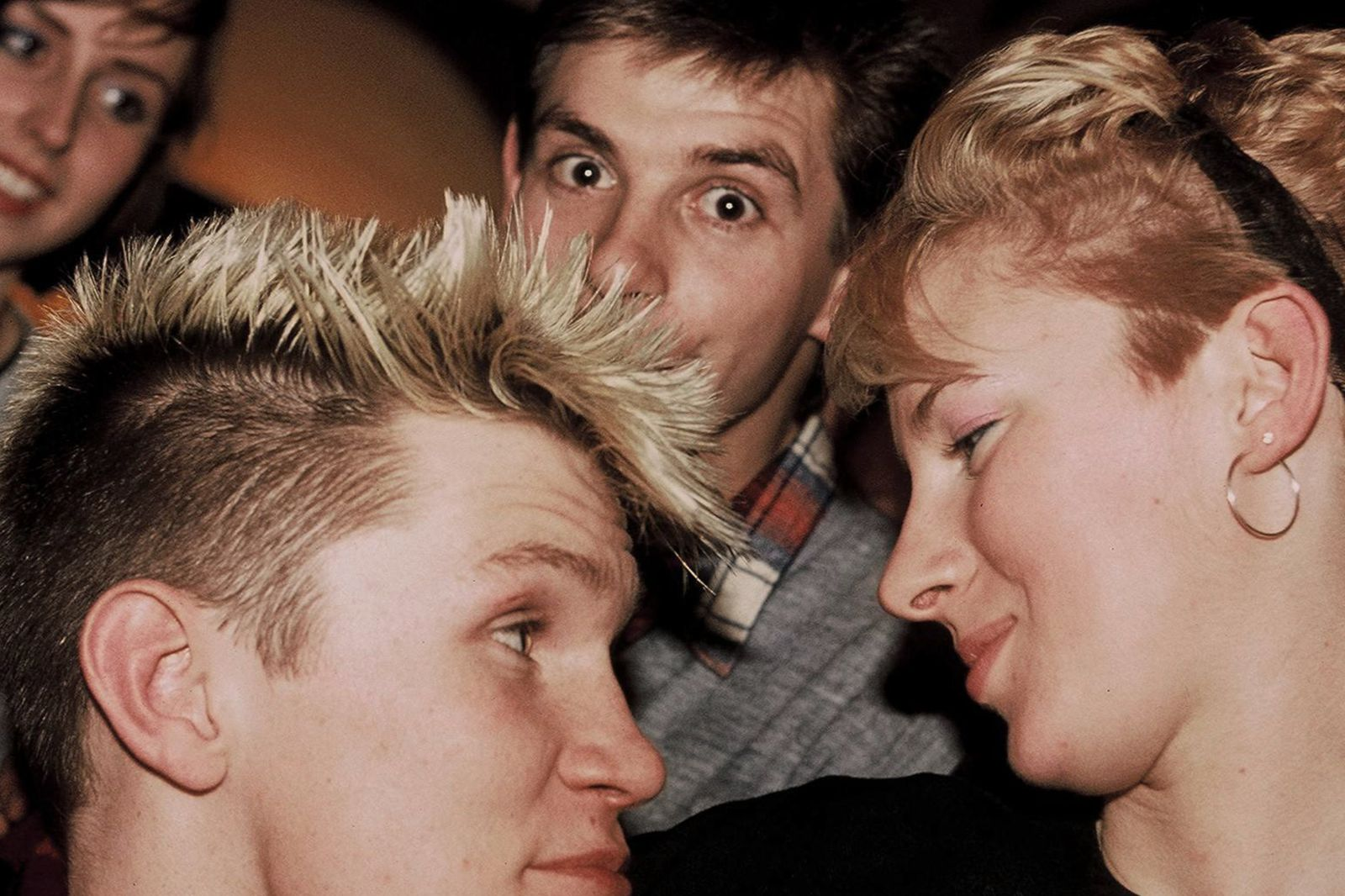Teenagers having fun in the pub,xmas eve, west London 1983.