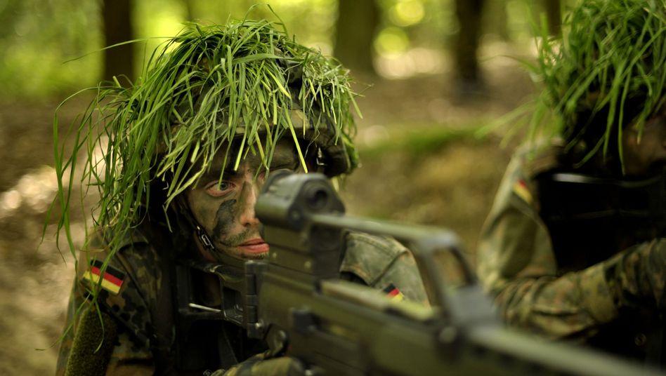 Deutscher Soldat mit Waffe von Heckler & Koch: Umstrittener Exportschlager