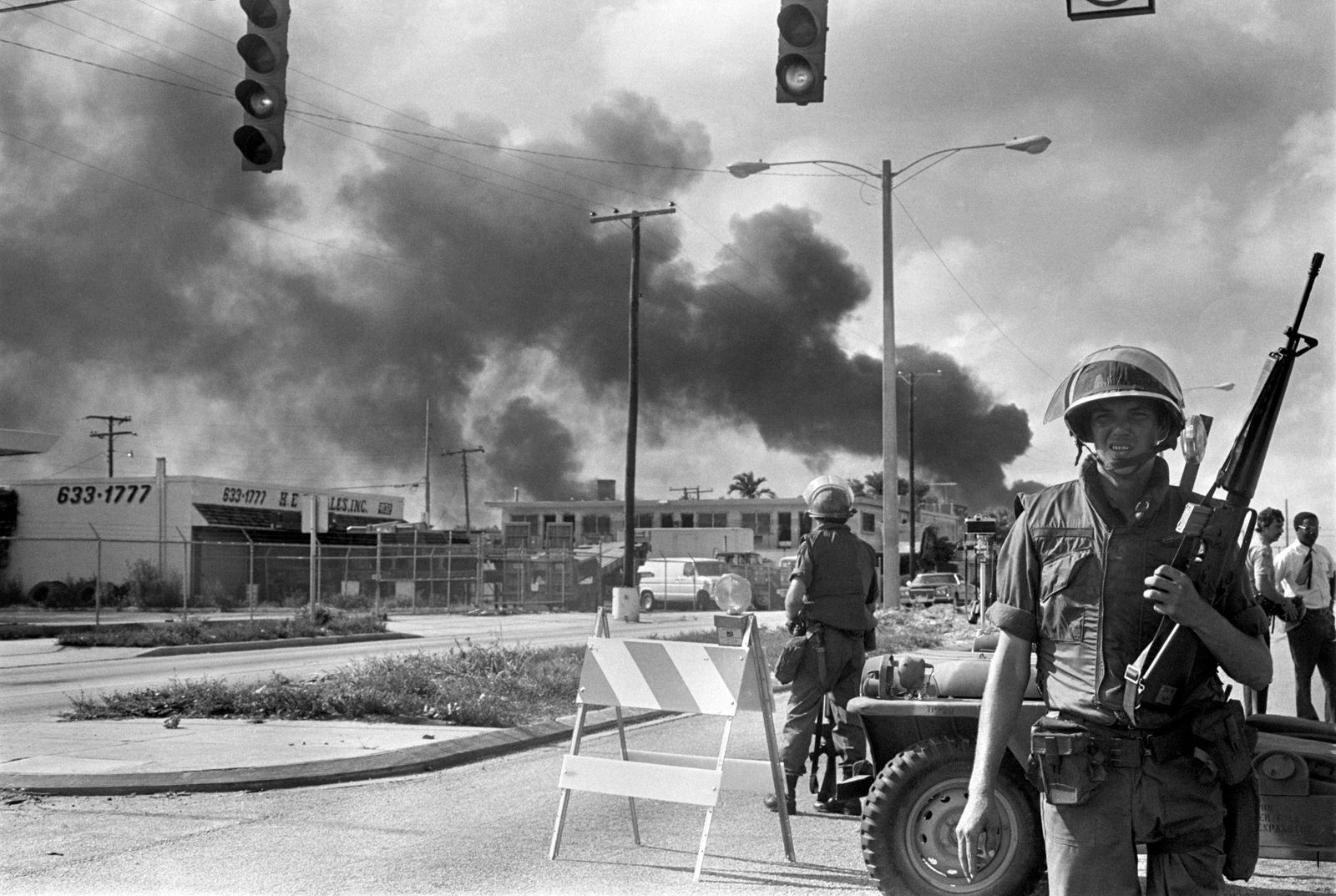 Guardsman Directing Traffic Away from Fire