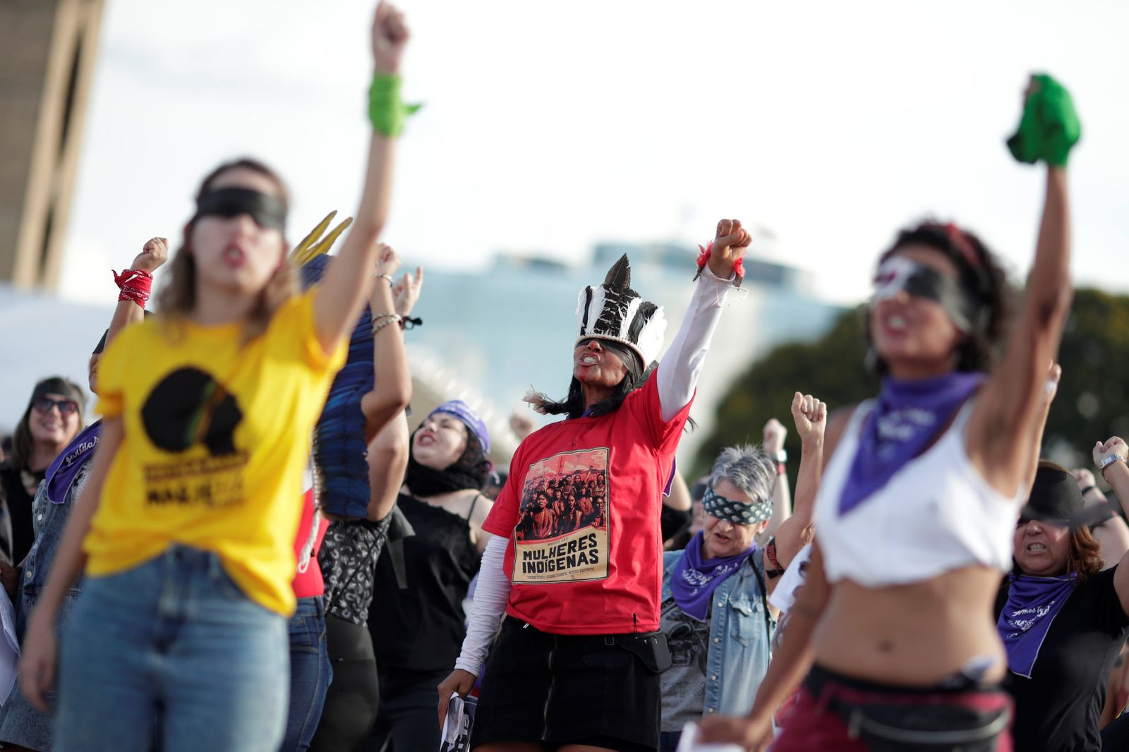 "Women perform the feminist anthem ""A rapist in your path,"" in a demonstration against gender-based violence in Brasilia"