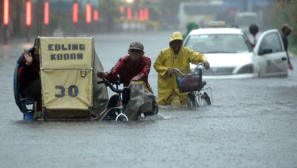 Tropensturm auf den Philippinen: Manila versinkt im Hochwasser