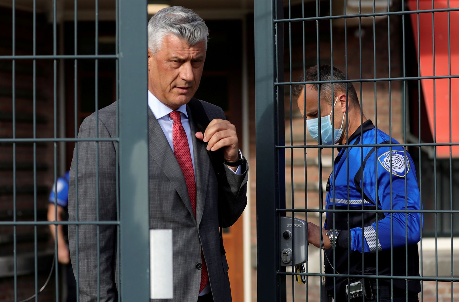 FILE PHOTO: Kosovo's President Hashim Thaci leaves after being interviewed by war crimes prosecutors after being indicted by a special tribunal, in The Hague