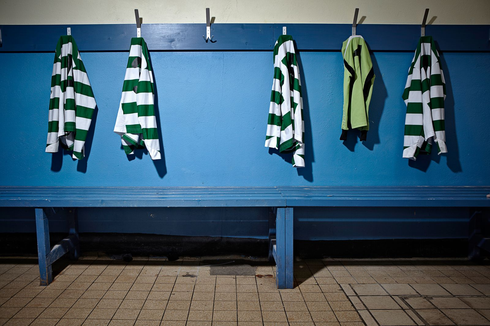 A empty changing room with football strips