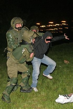 Father's Day can often get out of control in Germany. Here, a man is arrested on Father's Day in 2005.