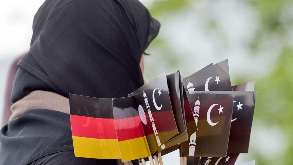 Eine verschleierte Frau in Deutschland