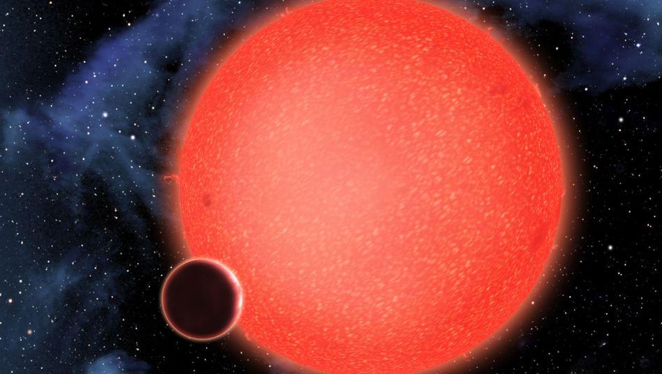 Fern des Sonnensystems: Exoplanet GJ 1214b vor seinem Heimatstern, einem Roten Zwerg