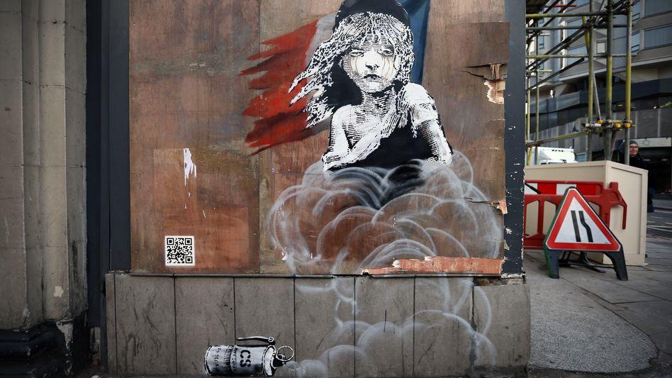 Graffito in London: Banksy kritisiert Tränengaseinsatz gegen Flüchtlinge