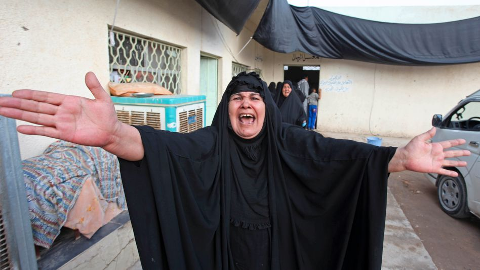 A Muslim mother laments the death of her son, killed in Baghdad after a suicide bombing.