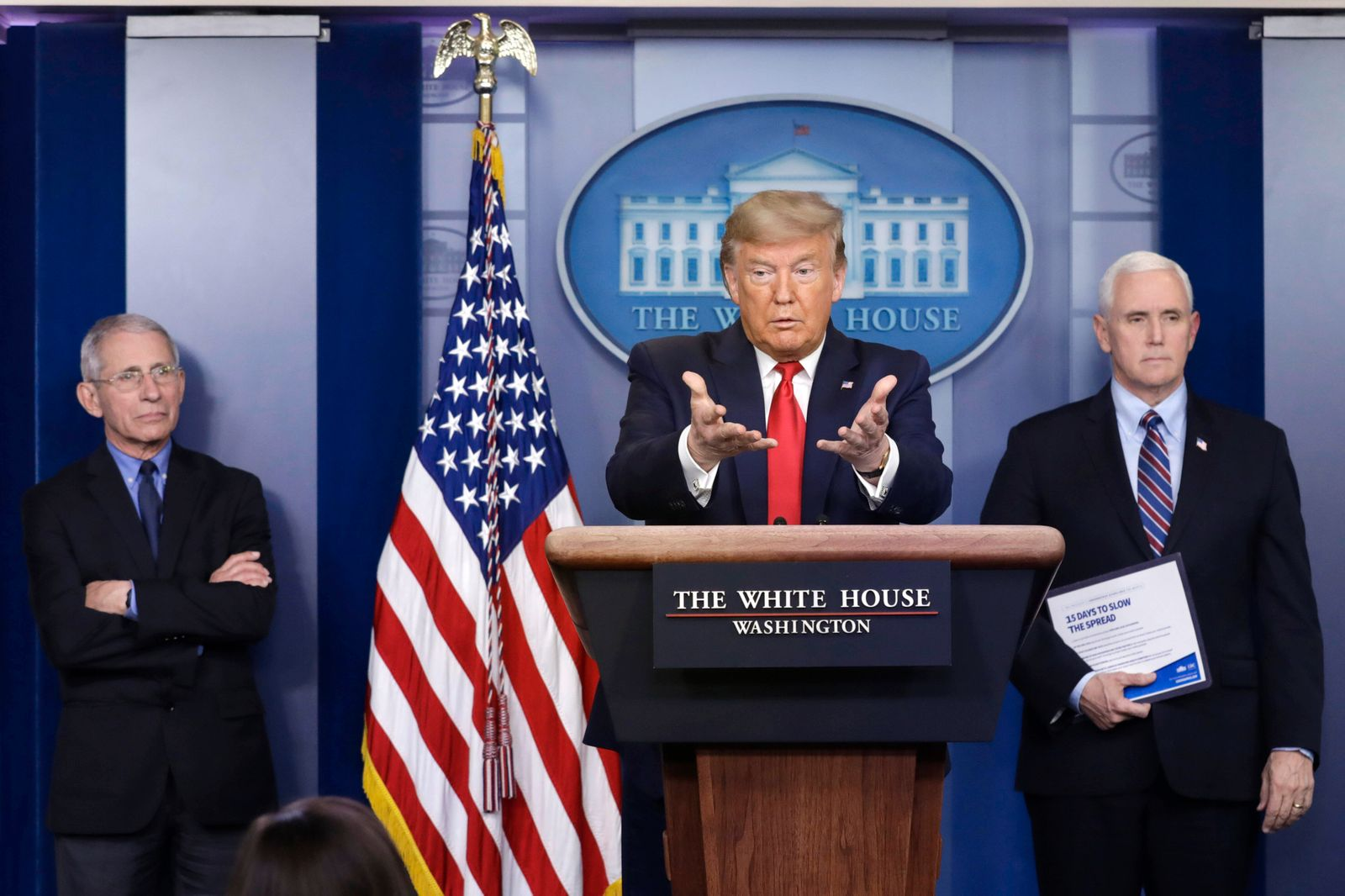 United States President Donald J. Trump, center, speaks as US Vice President Mike Pence, right, and Director of the Nat
