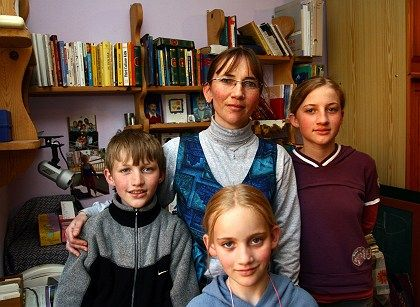 Tilmann Geske's wife Susanne, shown here with the couple's three children, says she will pray for her husband's killers.