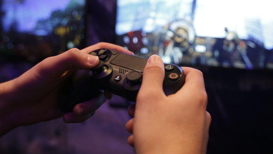 Playstation-Spieler (auf der Gamescom): Sony expandiert in Asien