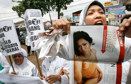 Playboy may be off the hook for now, but a new law requiring conservative dress is making its way through Indonesian parliament.