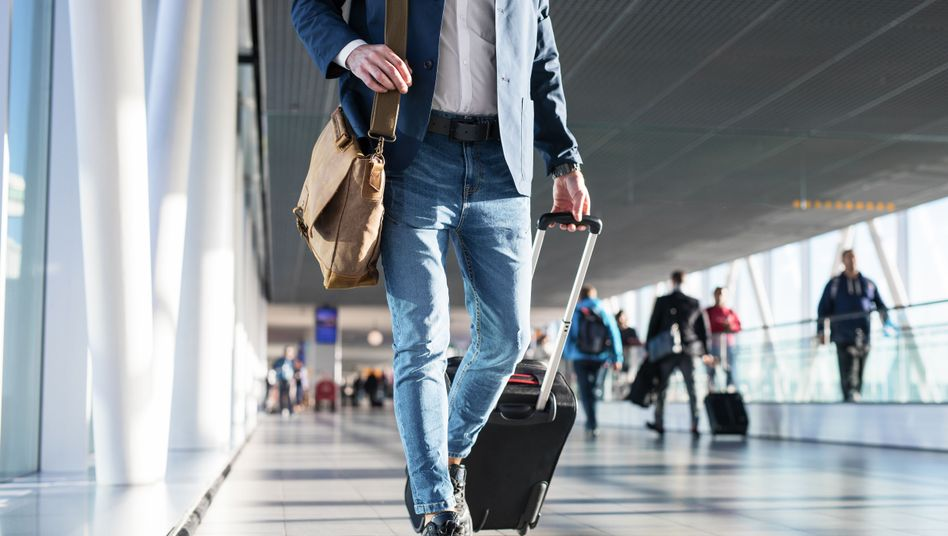 Flughafenpassagiere (Symbolbild)