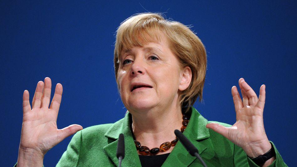 Die Kanzlerin in Aktion: Meist ist Deutschland auf einem guten Weg - aber dieser ist steinig