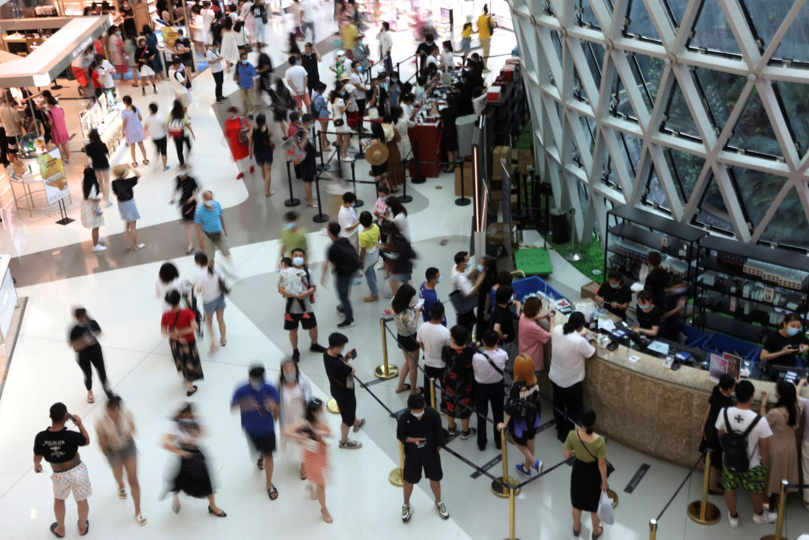 People shop at the Sanya International Duty-Free Shopping Complex in Sanya