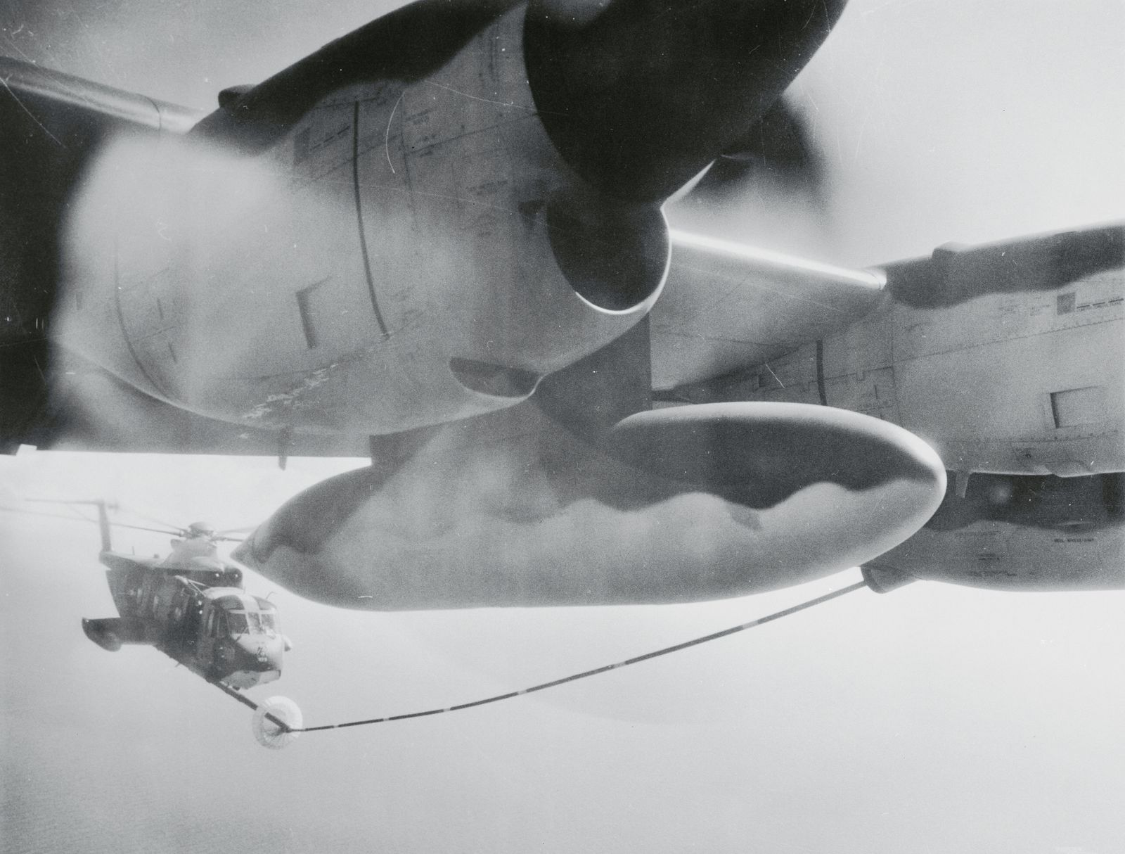 Airliner Refuelling a Helicopter