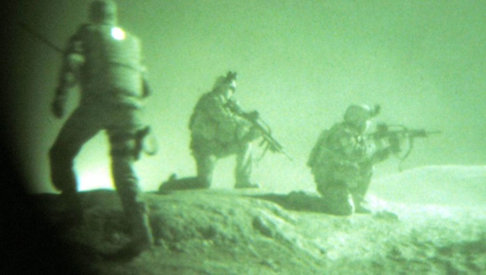 Unidentified troops conduct a night-time drill in the Marmal mountains near Mazar-e-Sharif. Members of America's elite Task Force 373 share a base with Germany's army in the region.