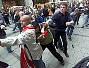 English and German soccer fans fight each otheron Munich's central square in2001. Polish hooligans hope to join the big leagues this summer.