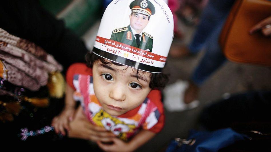 Kind bei einer Demonstration für General Sisi in Kairo: »Zwischen Chaos und Stabilität wählen«