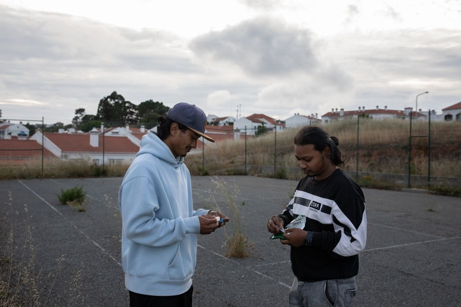 Suraj and his housemates relax after work on the outskirts of São Teotónio. Two thirds of the town's residents are thought to be migrant workers.