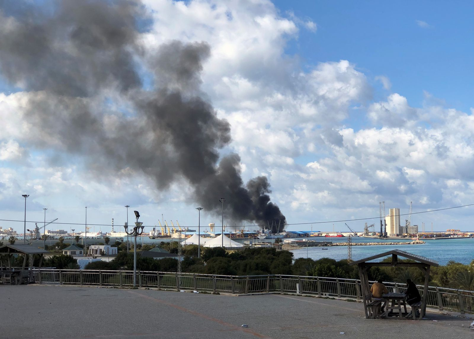 Smoke rises from a port of Tripoli after being attacked in Tripoli