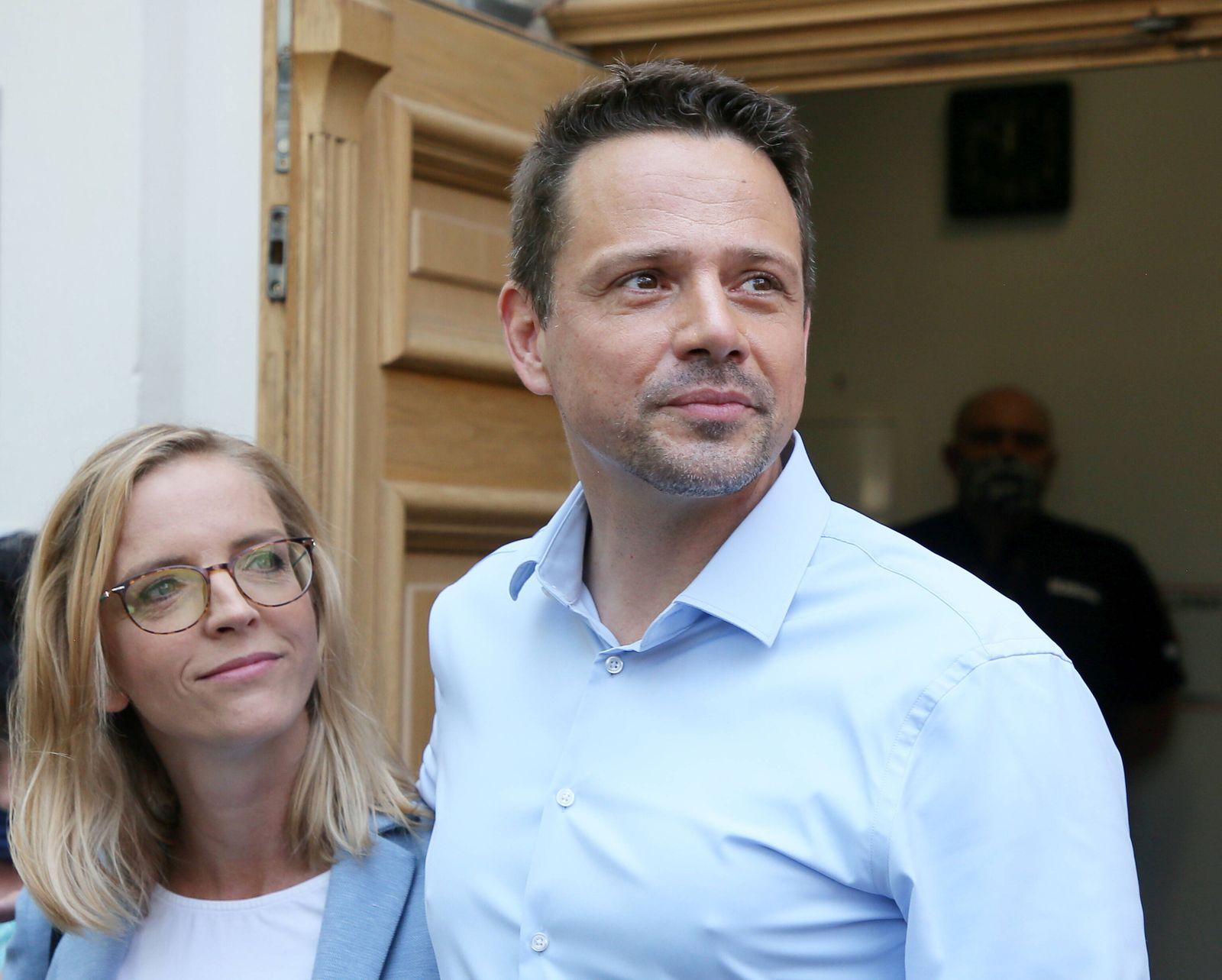The Civic Coalition presidential candidate Rafal Trzaskowski and his wife Malgorzata Trzaskowska cast their ballots at