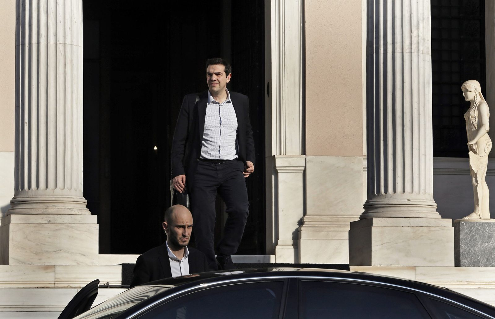 Greek PM Tsipras leaves his office in Athens