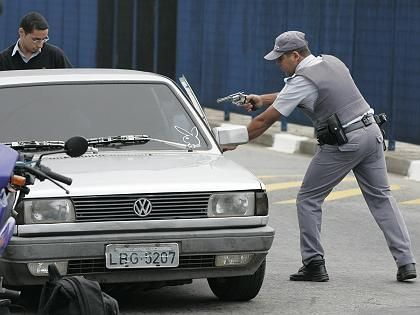 A Sao Paolo policeman stops a car to check for weapons after four days of gangster violence in May.