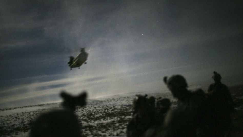 A Chinook helicopter lands to pick up US troops following a night-time raid in February.