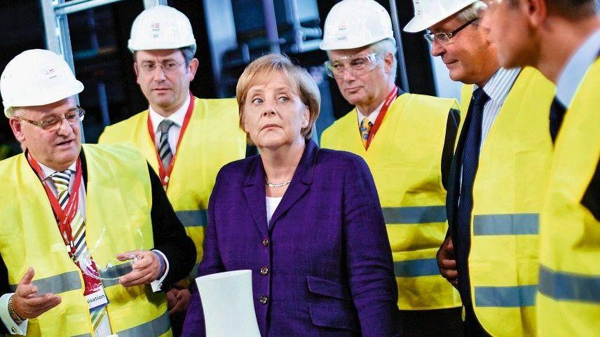 Kanzlerin Merkel, Umweltminister Norbert Röttgen (r.), Energiemanager(*): Wahl zwischen schwarzem Elend und gelbem Verderben