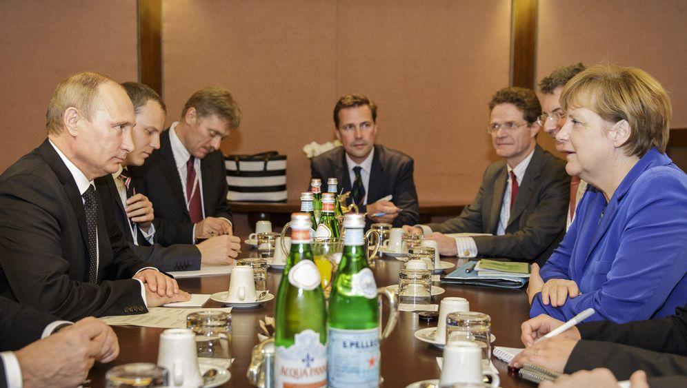 Putin und Merkel in Mailand: Späte Gespräche