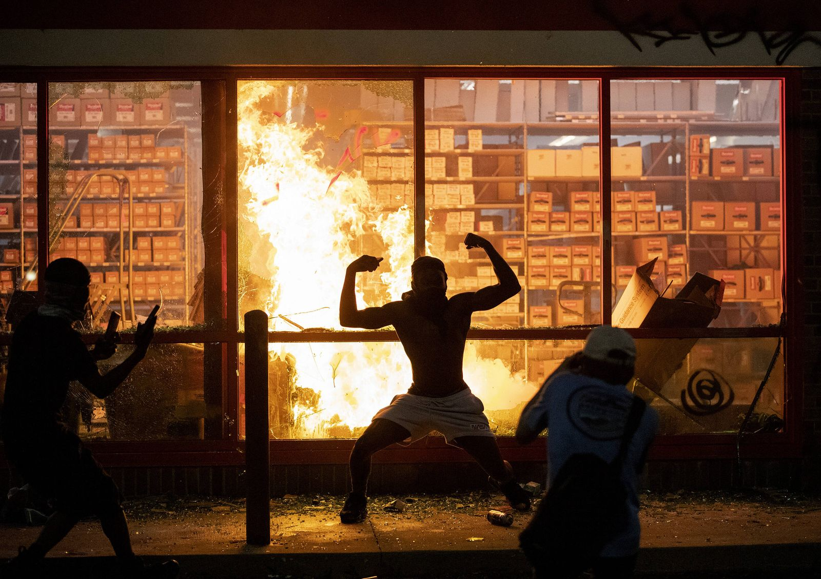 May 27, 2020, Minneapolis, MN, USA: A fire burns at an AutoZone store in Minneapolis on Wednesday, May 27, 2020, as pro