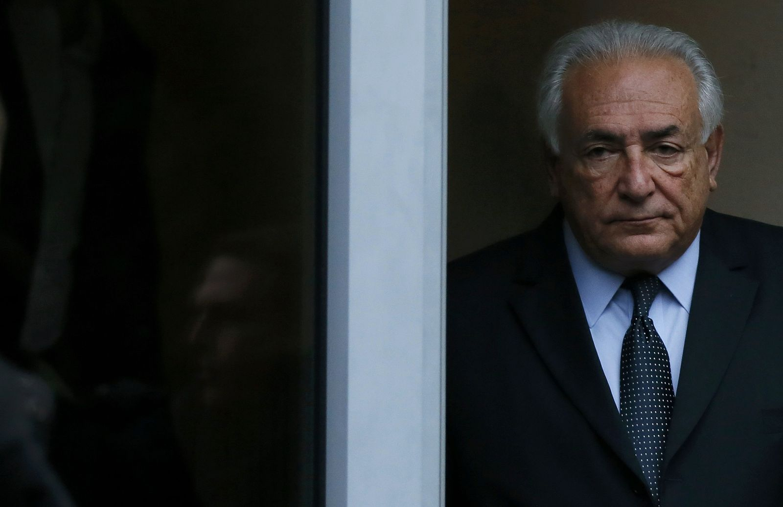 Former IMF head Strauss-Kahn leaves his hotel to attend the trial in the so-called Carlton Affair