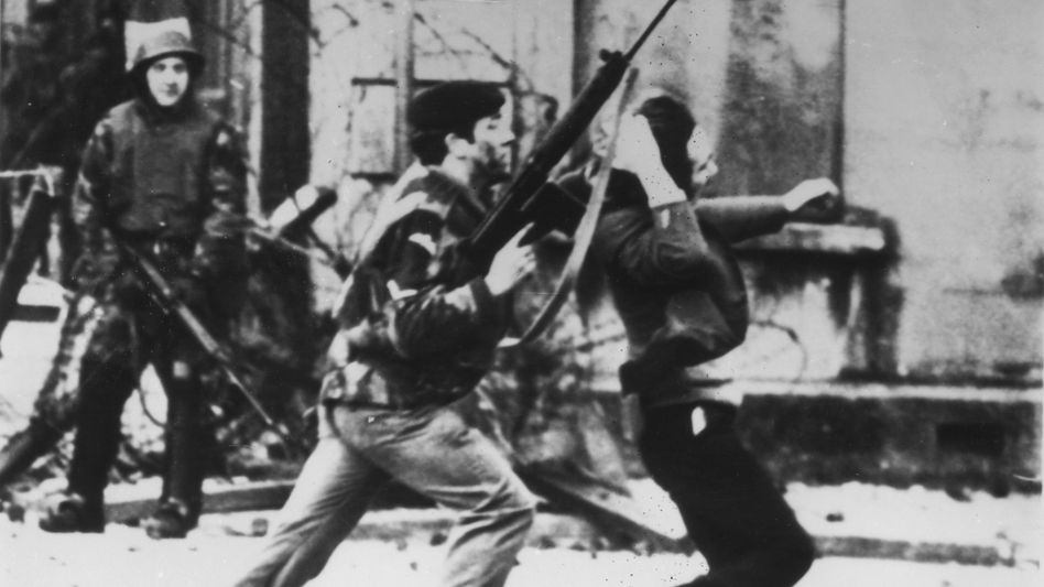A soldier apprehends a demonstrator on Bloody Sunday in Derry in 1972. Fourteen people were killed on that day, many of them shot in the back.