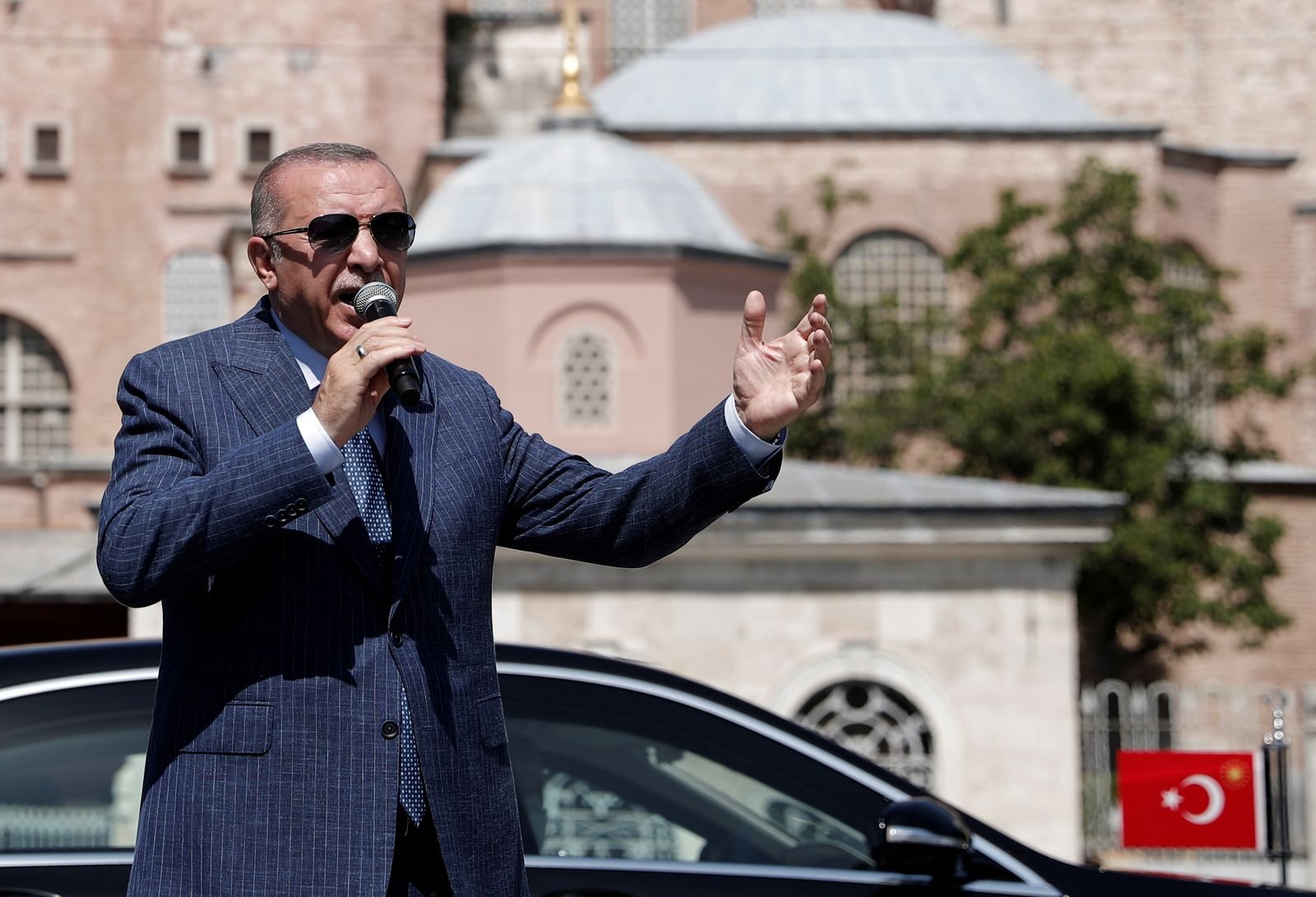FILE PHOTO: Turkish President Erdogan talks to the media after attending Friday prayers at Hagia Sophia Grand Mosque in Istanbul