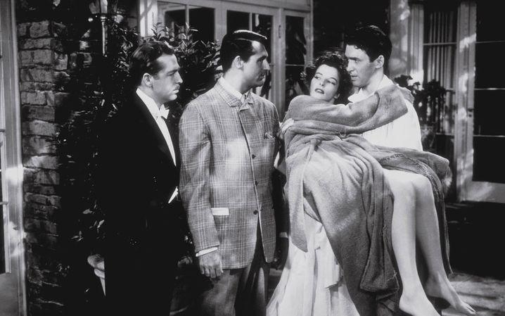"""John Howard, Cary Grant, Katharine Hepburn und James Stewart in """"Philadelphia Story"""": Stars in Champagner-Laune"""