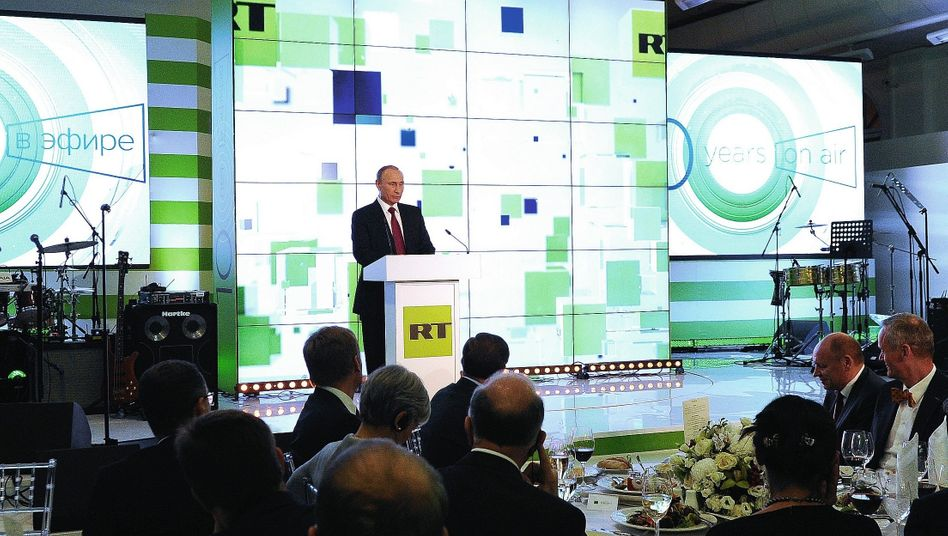 Russian President Vladimir Putin during a visit to RT in Moscow in 2015