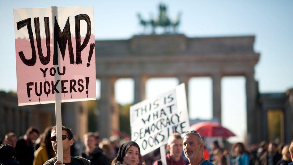 Demonstrators protest against banks in October in front of Berlin's Brandenburg Gate.