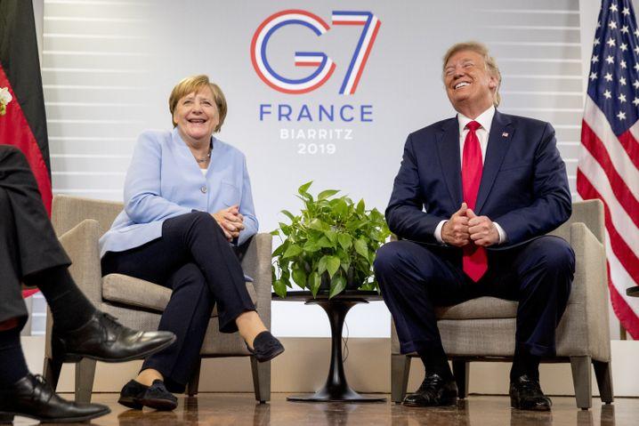 Angela Merkel und Donald Trump: Der US-Präsident kündigte einen Deutschland-Besuch an