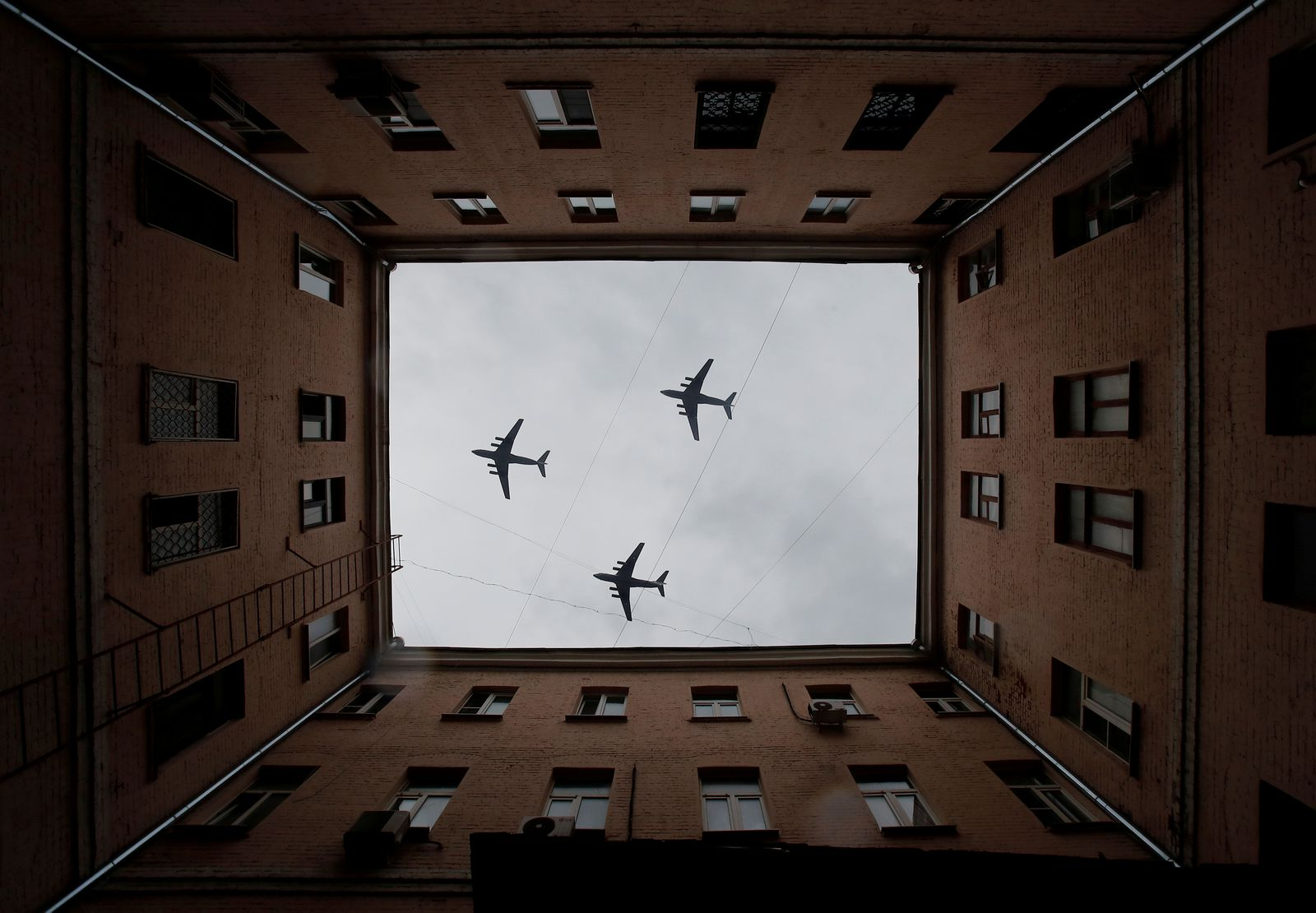 Russian military aircraft fly over Moscow during a rehearsal for the Victory Day flypast in Moscow