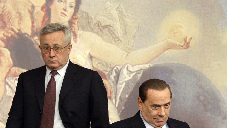 Not the best of friends: Italian Finance and Economy Minister Giulio Tremonti (L) at a news conference with Prime Minister Silvio Berlusconi in August.